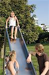 Family playing on slide Stock Photo - Premium Royalty-Free, Artist: Cultura RM, Code: 6114-06604708