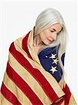 Woman wearing a flag Stock Photo - Premium Royalty-Freenull, Code: 6114-06604733