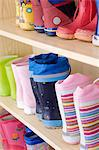 Rubber boots on a shelf Stock Photo - Premium Royalty-Free, Artist: Blend Images, Code: 6114-06604936