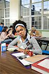 Girl working by herself in cafeteria Stock Photo - Premium Royalty-Free, Artist: Rick Gomez, Code: 6114-06604997