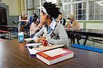 Girl by herself in cafeteria Stock Photo - Premium Royalty-Free, Artist: Andrew Kolb, Code: 6114-06605007