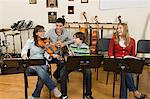 Friends at band practice Stock Photo - Premium Royalty-Free, Artist: ableimages, Code: 6114-06605008