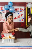 entry field - Girls shaking hands at student election Stock Photo - Premium Royalty-Freenull, Code: 6114-06605030
