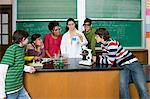 Teacher showing science experiment to pupils Stock Photo - Premium Royalty-Free, Artist: Blend Images, Code: 6114-06605031