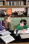 Girl copying boy in class Stock Photo - Premium Royalty-Free, Artist: Minden Pictures, Code: 6114-06605033