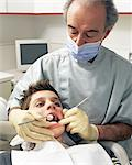 Dentist examining boy's teeth Stock Photo - Premium Royalty-Free, Artist: Uwe Umstätter, Code: 6114-06605137