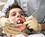 Close-up of boy having teeth examined Stock Photo - Premium Royalty-Free, Artist: Uwe Umstätter, Code: 6114-06605138