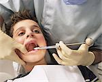 Close-up of dentist putting syringe in boy's mouth Stock Photo - Premium Royalty-Free, Artist: Dana Hursey, Code: 6114-06605142