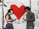 Teenage couple sending text messages Stock Photo - Premium Royalty-Free, Artist: CulturaRM, Code: 6114-06605248