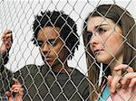 Two teenagers stood behind fence Stock Photo - Premium Royalty-Free, Artist: CulturaRM, Code: 6114-06605251