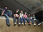 Group of teenagers at skate ramp Stock Photo - Premium Royalty-Free, Artist: Blend Images, Code: 6114-06605252