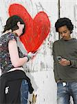 Teenage couple sending text messages Stock Photo - Premium Royalty-Free, Artist: CulturaRM, Code: 6114-06605260