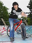 Teenage boy with bmx Stock Photo - Premium Royalty-Free, Artist: Blend Images, Code: 6114-06605265