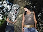 Young couple playing with halloween mask Stock Photo - Premium Royalty-Free, Artist: GreatStock, Code: 6114-06605267