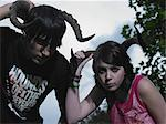 Two teenagers holding animal horns Stock Photo - Premium Royalty-Freenull, Code: 6114-06605273