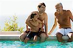 family cooling off by the swimming pool Stock Photo - Premium Royalty-Free, Artist: CulturaRM, Code: 6114-06605387