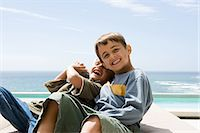 Two brothers tickling each other Stock Photo - Premium Royalty-Freenull, Code: 6114-06605413