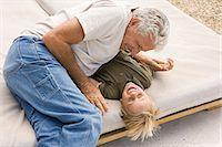 Grandparent and grandchild playing Stock Photo - Premium Royalty-Freenull, Code: 6114-06605420