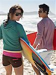 Couple going surfing Stock Photo - Premium Royalty-Free, Artist: Cultura RM, Code: 6114-06605451