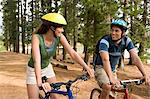 Couple cycling in forest Stock Photo - Premium Royalty-Free, Artist: CulturaRM, Code: 6114-06605548