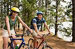 Couple cycling in forest Stock Photo - Premium Royalty-Free, Artist: CulturaRM, Code: 6114-06605572