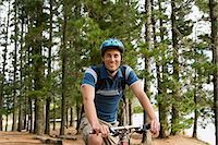 Cyclist in the forest Stock Photo - Premium Royalty-Freenull, Code: 6114-06605574
