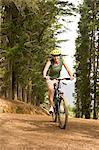 Cyclist in the forest Stock Photo - Premium Royalty-Free, Artist: CulturaRM, Code: 6114-06605575