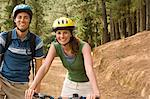 Couple cycling in forest Stock Photo - Premium Royalty-Free, Artist: CulturaRM, Code: 6114-06605576