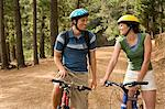 Couple cycling in forest Stock Photo - Premium Royalty-Free, Artist: CulturaRM, Code: 6114-06605581
