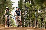 Couple cycling in forest Stock Photo - Premium Royalty-Free, Artist: CulturaRM, Code: 6114-06605582