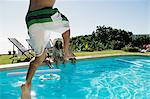 Man jumping into swimming pool Stock Photo - Premium Royalty-Free, Artist: ableimages, Code: 6114-06605643