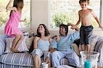 Family relaxing indoors Stock Photo - Premium Royalty-Free, Artist: Ikon Images, Code: 6114-06605646