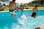 Father and son jumping in swimming pool Stock Photo - Premium Royalty-Free, Artist: Cultura RM, Code: 6114-06605663