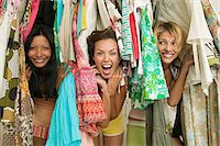 Friends looking through hanging clothes Stock Photo - Premium Royalty-Freenull, Code: 6114-06605699