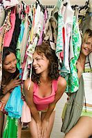Friends looking through clothes Stock Photo - Premium Royalty-Freenull, Code: 6114-06605731