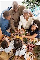 Family having a toast at christmas Stock Photo - Premium Royalty-Freenull, Code: 6114-06605770