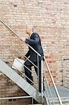 Businessman going up stairs Stock Photo - Premium Royalty-Free, Artist: CulturaRM, Code: 6114-06605859