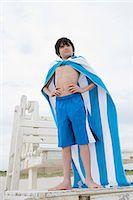 Boy posing as a superhero Stock Photo - Premium Royalty-Freenull, Code: 6114-06605880