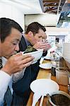 Businessmen eating Stock Photo - Premium Royalty-Free, Artist: Blend Images, Code: 6114-06605916
