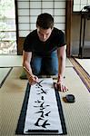 Man writing japanese script Stock Photo - Premium Royalty-Free, Artist: Blend Images, Code: 6114-06605918