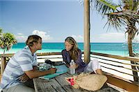 exotic outdoors - Couple preparing for trip Stock Photo - Premium Royalty-Freenull, Code: 6114-06606051