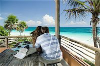 exotic outdoors - Couple by beautiful beach Stock Photo - Premium Royalty-Freenull, Code: 6114-06606066