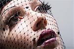 Woman wearing net over face Stock Photo - Premium Royalty-Free, Artist: Blend Images, Code: 6114-06606081