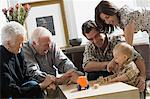 Little boy with parents and grandparents Stock Photo - Premium Royalty-Free, Artist: Blend Images, Code: 6114-06606146