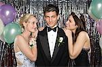 Teenage boy with two girls at prom Stock Photo - Premium Royalty-Free, Artist: Westend61, Code: 6114-06606150