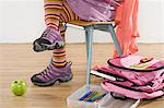 Girl on a chair with school things Stock Photo - Premium Royalty-Free, Artist: Ty Milford, Code: 6114-06606154