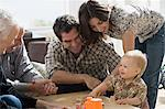 Little boy with parents and grandparents Stock Photo - Premium Royalty-Freenull, Code: 6114-06606156