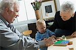 Grandparents and baby with building blocks Stock Photo - Premium Royalty-Free, Artist: CulturaRM, Code: 6114-06606158