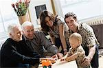 Little boy with parents and grandparents Stock Photo - Premium Royalty-Free, Artist: Blend Images, Code: 6114-06606162