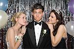 Teenage boy with two girls at prom Stock Photo - Premium Royalty-Free, Artist: Westend61, Code: 6114-06606164